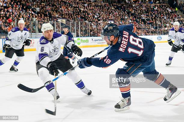 Ethan Moreau of the Edmonton Oilers takes a shot past a defending Sean O'Donnell of the Los Angeles Kings at Rexall Place on November 25 2009 in...