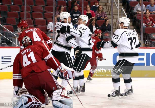 Ethan Moreau of the Los Angeles Kings celebrates with teammates Trevor Lewis and Tyler Toffoli after Moreau scored a first period goal past...