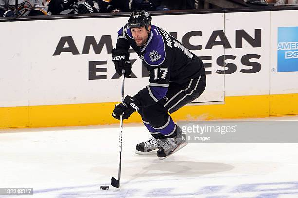 Ethan Moreau of the Los Angeles Kings skates with the puck against the Nashville Predators at Staples Center on November 8 2011 in Los Angeles...