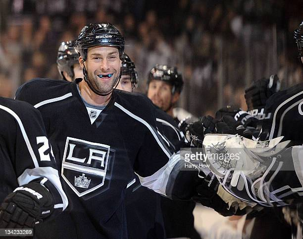 Ethan Moreau of the Los Angeles Kings smiles as he celebrates his goal with the bench for a 10 lead over the San Jose Sharks during the first period...