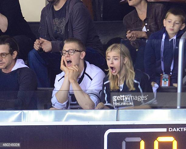 Ethan Moretz and Chloe Moretz attend a hockey game between the New York Rangers and the Los Angeles Kings in Game Two of the 2014 NHL Stanley Cup...