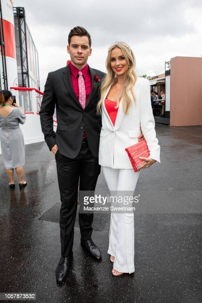 Ethan Panizza and Alicia Banit pose at the Melbourne Cup Day at Flemington Racecourse on November 6 2018 in Melbourne Australia