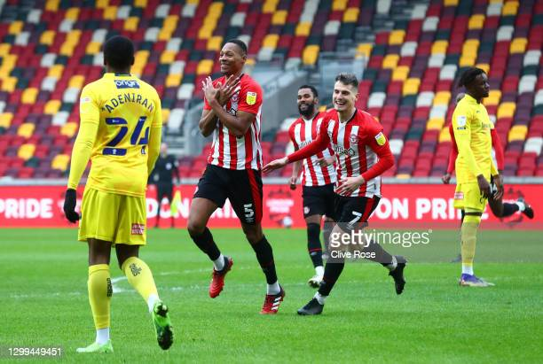 Ethan Pinnock of Brentford celebrates after scoring their team's first goal as Sergi Canos looks on during the Sky Bet Championship match between...