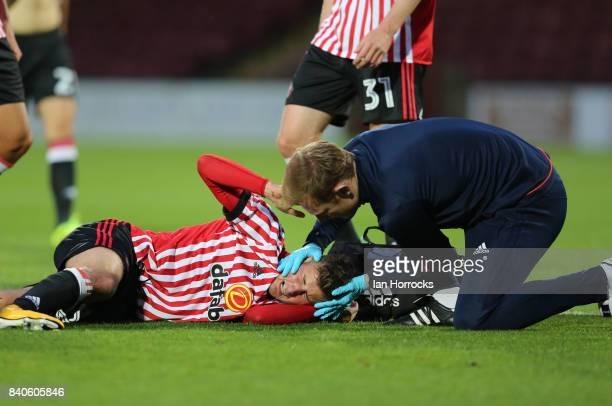 Ethan Robson of Sunderland is injured during the Checkertrade Trophy group stage match at Glanford Park on August 29 2017 in Scunthorpe England
