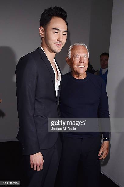 Ethan Ruan and Giorgio Armani attend the Emporio Armani Show as a part of Milan Menswear Fashion Week Fall Winter 2015/2016 on January 19 2015 in...