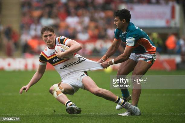 Ethan Ryan of Bradford Bulls and Kieran Moss of Hull KR in action during the Rugby League Summer Bash match between Hull KR and Bradford Bulls at...