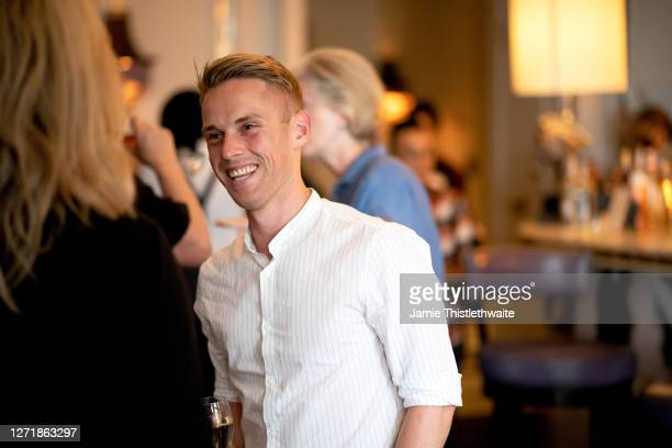 """Ethan Spibey smiles during the """"Henpire"""" podcast launch event at Langham Hotel on September 10, 2020 in London, England."""