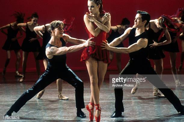 Ethan Stiefel Amanda Schull and Sascha Radetsky dance on stage in a scene from the film 'Center Stage' 2000