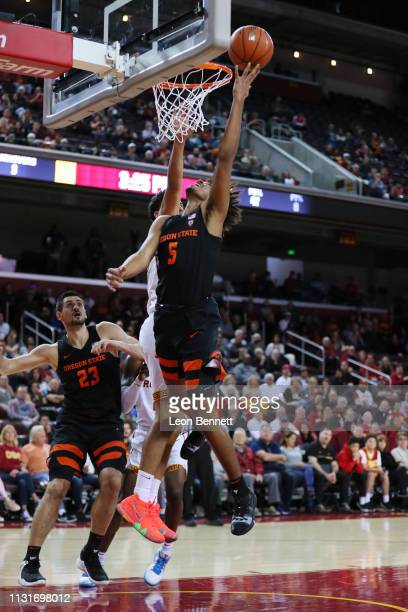 Ethan Thompson of the Oregon State Beavers goes to the basket against Bennie Boatwright of the USC Trojans during a college basketball game at Galen...