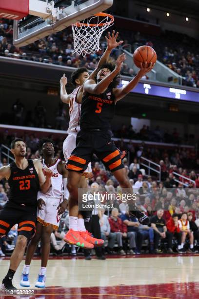 Ethan Thompson of the Oregon State Beavers handles the ball against Bennie Boatwright of the USC Trojans during a college basketball game at Galen...