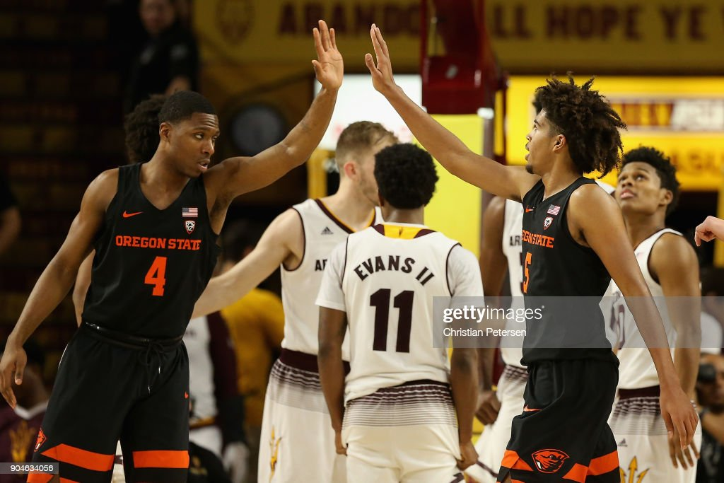 Ethan Thompson #5 (R) of the Oregon State Beavers high fives Alfred Hollins #4 after scoring against the Arizona State Sun Devils during the second half of the college basketball game at Wells Fargo Arena on January 13, 2018 in Tempe, Arizona. The Sun Devils defeated the Beavers 77-75.