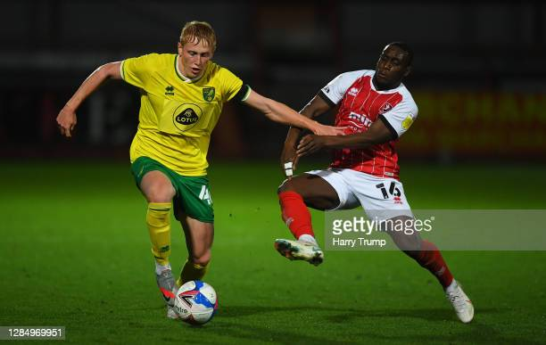 Ethan Vaughan of Norwich City Under 21's is tackled by Alex Addai of Cheltenham Town during the EFL Trophy match between Cheltenham Town and Norwich...