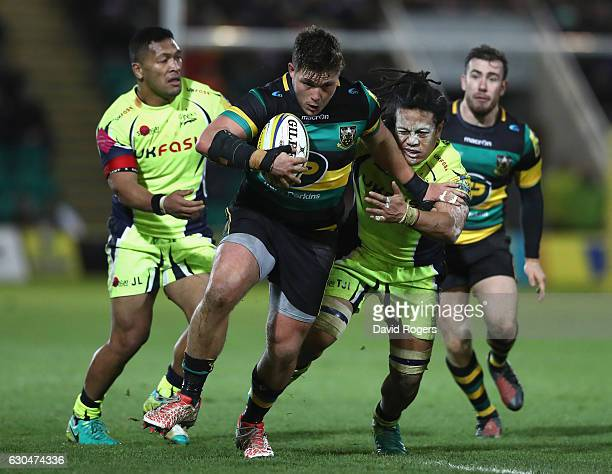 Ethan Waller of Northampton holds off TJ Ioane during the Aviva Premiership match between Northampton Saints and Sale Sharks at Franklin's Gardens on...