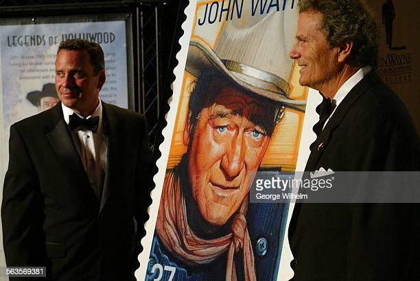 4/3/2004 – Ethan Wayne left and Patrick Wayne unveil a stamp honoring their father John Wayne at the Beverly Hilton Hotel in Beverly Hills
