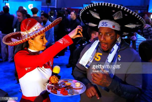 Ethan Westbrooks of the Los Angeles Rams reacts as he is offered a scorpion from a reporter from Televisa during Super Bowl LIII Opening Night at...