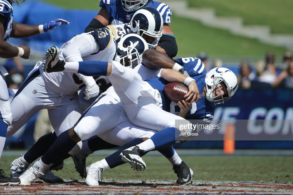 Ethan Westbrooks #93 of the Los Angeles Rams sacks Scott Tolzien #16 of the Indianapolis Colts during the third quarter at Los Angeles Memorial Coliseum on September 10, 2017 in Los Angeles, California.