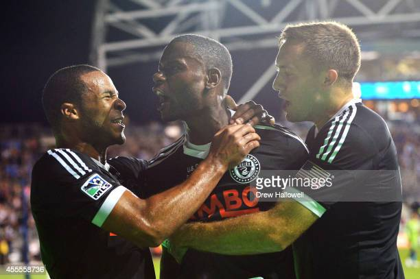 Ethan White and Andrew Wenger of the Philadelphia Union congratulate Maurice Edu after scoring a first half goal against the Seattle Sounders FC...
