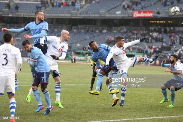 Ethan White of New York City FC and Adrian Arregui of Montreal Impact challenge for a cross from a free kick during the New York City FC Vs Montreal...