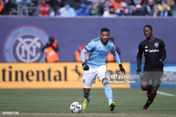 Ethan White of New York City FC challenged by Patrick Nyarko of DC United during the NYCFC Vs DC United regular season MLS game at Yankee Stadium on...