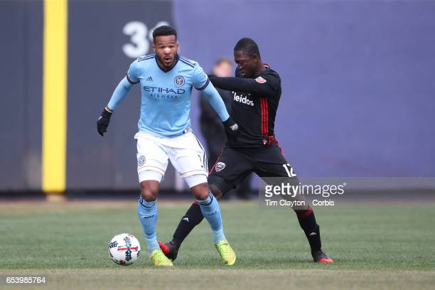 Ethan White of New York City FC is challenged by Patrick Nyarko of DC United during the NYCFC Vs DC United regular season MLS game at Yankee Stadium...
