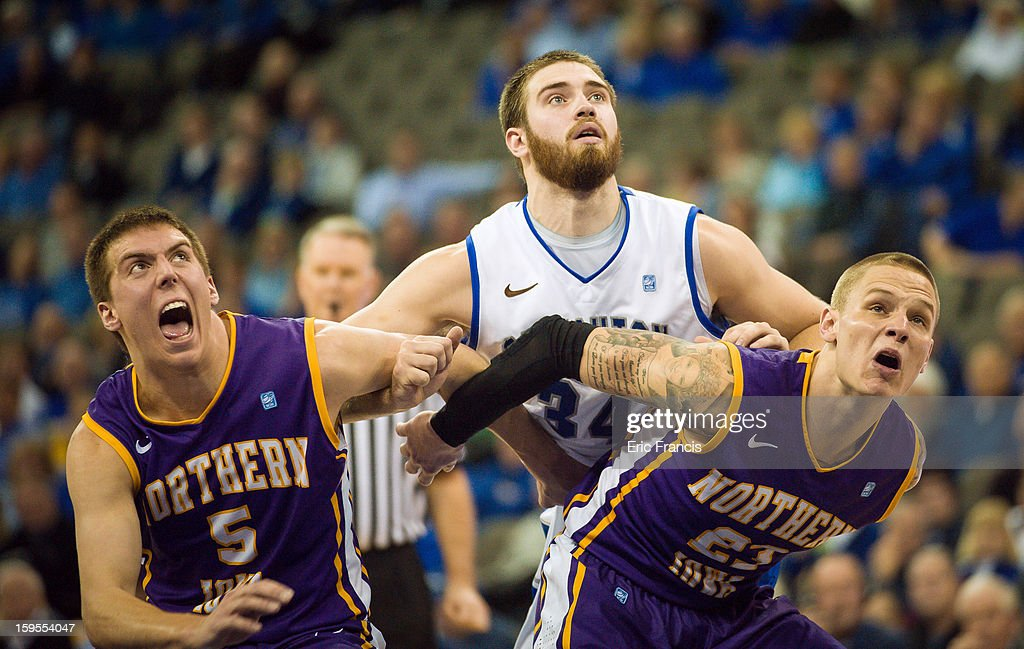 Ethan Wragge #34 of the Creighton Bluejays battles for position with Matt Bohannon #5 and Marc Sonnen #23 of the Northern Iowa Panthers during their game at the CenturyLink Center on January 15, 2013 in Omaha, Nebraska. Creighton defeated Northern Iowa 79-68.
