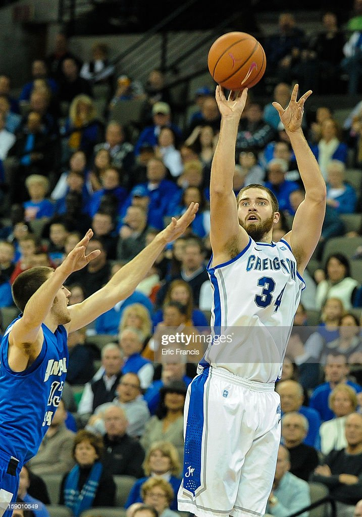 Ethan Wragge #34 of the Creighton Bluejays drains a three point shot over Jake Odum #13 of the Indiana State Sycamores during their game at the CenturyLink Center on January 5, 2013 in Omaha, Nebraska. Creighton defeated Indiana State 79-66.
