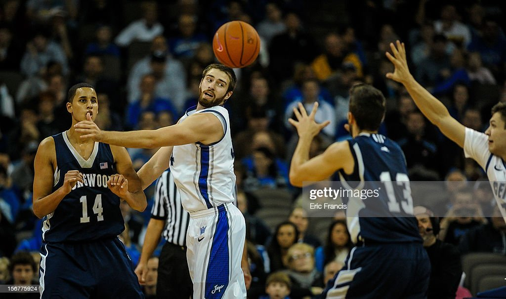 Ethan Wragge #34 of the Creighton Bluejays tries to block a pass from Michael Kessens #14 to David Robinson #13 of the Longwood Lancers during their game at CenturyLink Center on November 20, 2012 in Omaha, Nebraska.