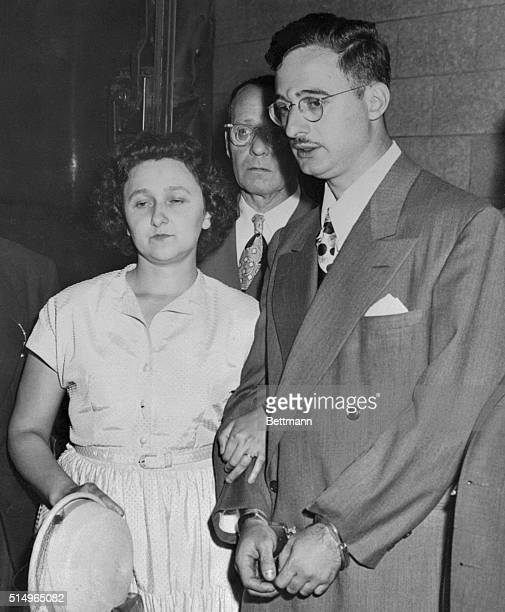 Ethel and Julius Rosenberg are shown leaving New York City Federal Court after arraignment.