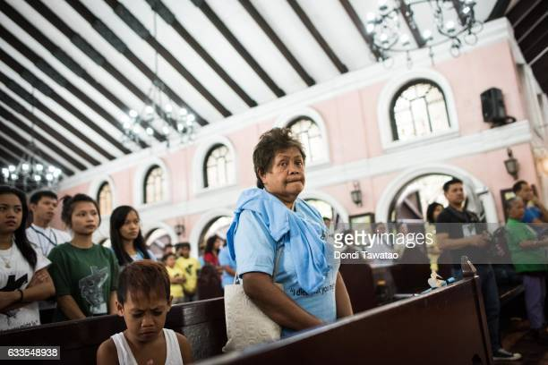 Ethel De Chaves mother of slain transgender Heart de Chavez listens during a mass held for victims of the drug war on February 2 2017 in Manila...