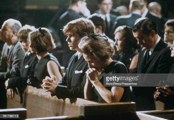 Ethel Kennedy bows her head alongside three of her children as they sit in a pew in Saint Patrick's Cathedral New York during the funeral and requiem...