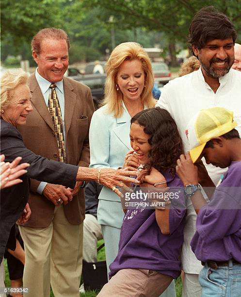 Ethel Kennedy wife of Robert F Kennedy US television sports broadcaster Frank Gifford and his singeractress wife Kathie Lee playfully hug Jessica...
