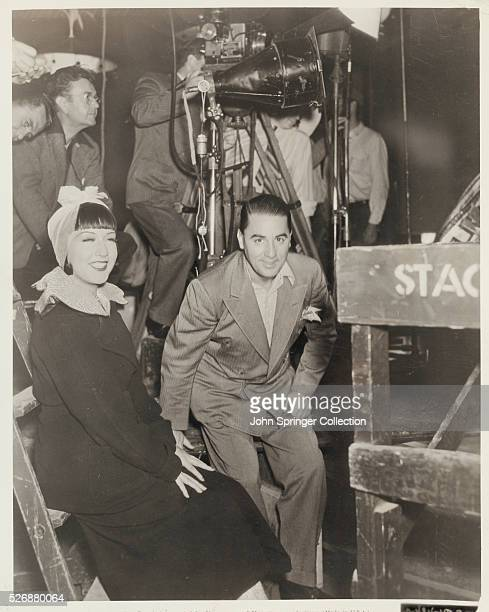 Ethel Merman sits with studio dance director LeRoy Prinz on the set of Anything Goes