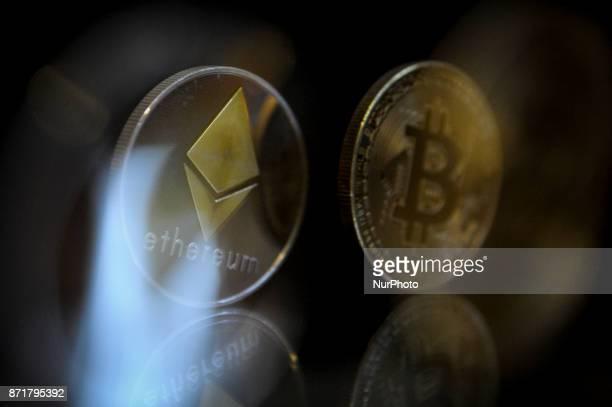 Ether and Bitcoin replica cryptocurrency coins are seen in this photo illustration on November 8 2017
