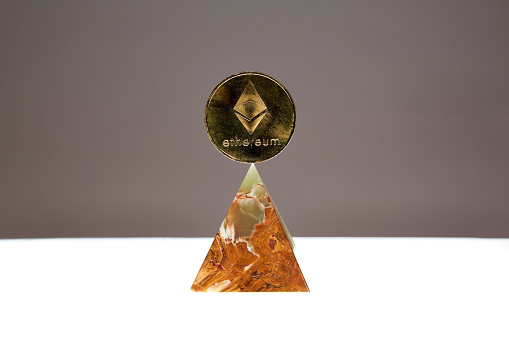 Ethereum Coin floating above an Onyx Stone Pyramid - gettyimageskorea