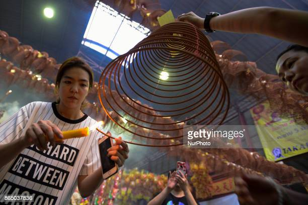 Ethic Chinese pray at a shrine in Joe Sue Kung Shrine Chinese temple in Bangkok Thailand on 22 October 2017 The festival celebrates the local Chinese...