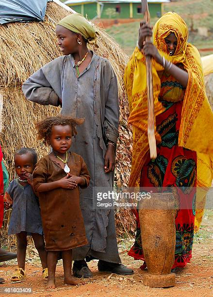 CONTENT] Ethiopia A Borana woman with her family pounding millet in a small village