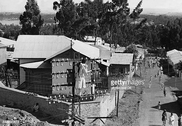 Ethiopia Addis Abeba Addis Abeba Telecommunications technician over the housetops of the city Photographer Alfred Eisenstaedt 1935Vintage property of...