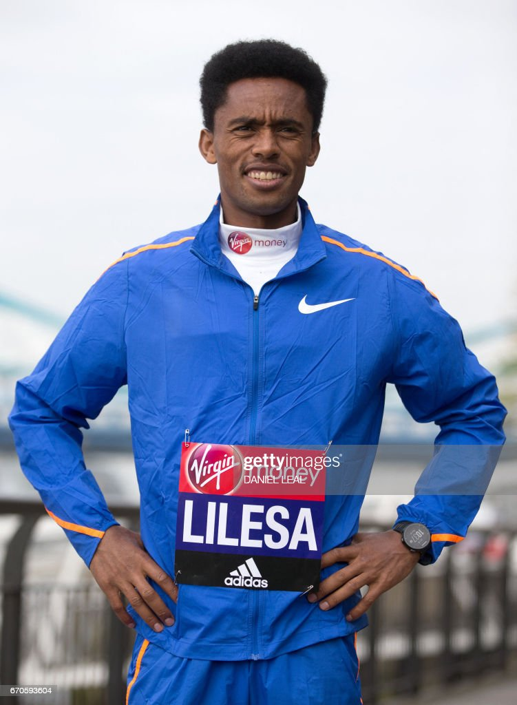 Ethiopia elite runner Feyisa Lilesa poses during a photocall for the men's marathon elite athletes outside Tower Bridge in central London on April 20, 2017 ahead of the upcoming London Marathon. / AFP PHOTO / Daniel LEAL
