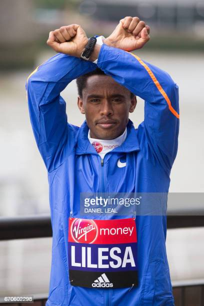 Ethiopia elite runner Feyisa Lilesa poses during a photocall for the men's marathon elite athletes outside Tower Bridge in central London on April 20...