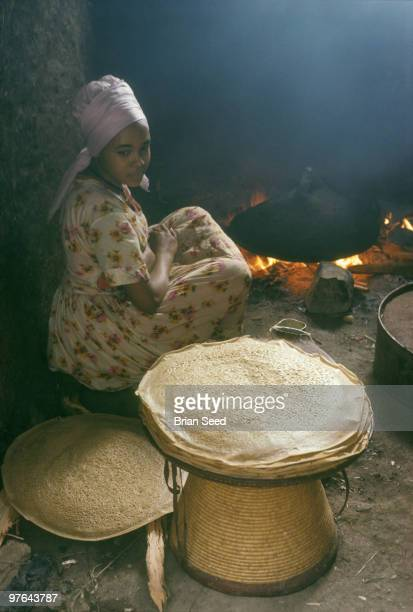 Ethiopia inside her tukul a round strawthatched hut Zentalem Desta cooks a supply of injera a staple food over a eucalyptus wood fire The grain used...