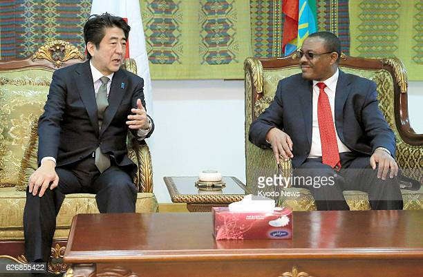 ABABA Ethiopia Japanese Prime Minister Shinzo Abe and Ethiopian Prime Minister Hailemariam Desalegn exchange words at the VIP room at Bole airport in...