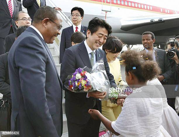 ABABA Ethiopia Japanese Prime Minister Shinzo Abe and his wife Akie receive flowers after arriving at Bole airport in Addis Ababa on Jan 13 2014...