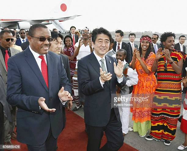 ABABA Ethiopia Japanese Prime Minister Shinzo Abe is greeted by Ethiopian Prime Minister Hailemariam Desalegn and others after arriving at Bole...