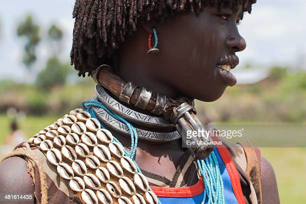 Ethiopia Lower Omo Valley Key Afir Banner woman wearing a necklace know as a Bignere an metal band with a phallic protuberance to signify that she is...