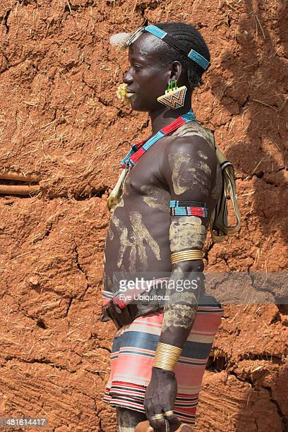 Ethiopia Lower Omo Valley Key Afir Tsemay man with flower in mouth at weekly market