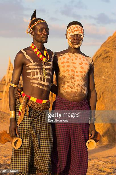 Ethiopia Lower Omo Valley Kolcho Karo men with body painting made from mixing animal pigments with clay