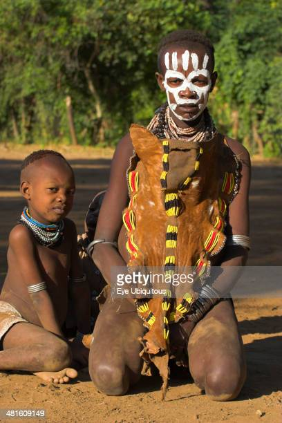 Ethiopia Lower Omo Valley Mago National Park Karo lady with child with face painting