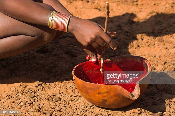Ethiopia Lower Omo Valley Tumi Dombo village Hamer lady stirring cows blood ready for drinking