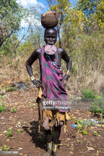 ethiopia: mursi woman with a lip plate - mursi tribe stock pictures, royalty-free photos & images