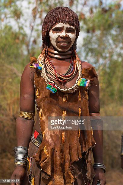 Ethiopia Omo Valley Mago National Park Woman with face painting her hair greased with ocher coloring and animal fat into plaits known as Goscha and...